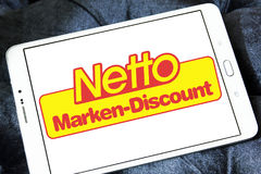 Netto stores logo. Logo of the international chain of convenience stores netto on samsung tablet Stock Image