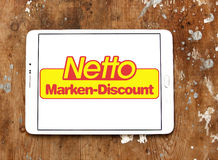 Netto stores logo. Logo of the international chain of convenience stores netto on samsung tablet on wooden background Royalty Free Stock Photography