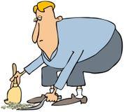 Nettoyage d'homme avec une pelle à poussière et un balai Image stock