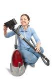 Nettoyer à l'aspirateur de sourire de femme Photo stock
