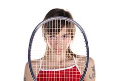 Network. Girl is looking through net on racket Stock Images