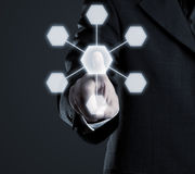 Network. Businessman navigating network on futuristic touchscreen Stock Image