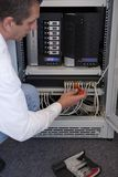Network administrator. Is working on a server Royalty Free Stock Photo