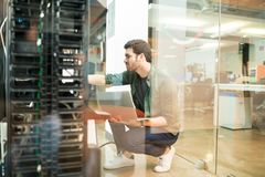 Free Network Administrator In Server Room Royalty Free Stock Photos - 120413208