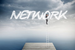 Network against cloudy sky over ocean Royalty Free Stock Images