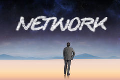 Network against serene landscape Stock Image