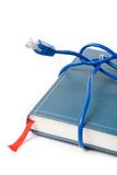 Network cable and book Royalty Free Stock Photography