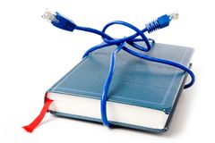 Network cable and book Royalty Free Stock Photo