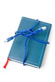 Network cable and book Stock Photo