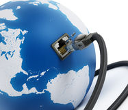 Network cable connected to the blue globe Royalty Free Stock Images
