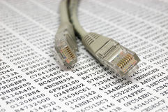 Network cable and encryption key. Network patch cable and encryption key Stock Photography