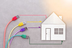 Network cable with house paper cut smart home concept Stock Image