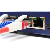 Network cable plugged in switch Stock Photo