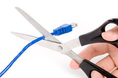 Network cable with scissors stock photography