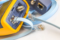 Network cable tester for RJ45 connectors  with cable. Connected for testing Royalty Free Stock Photos