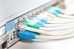 Network cables connected into. Router, shallow depth of field stock images