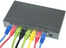Network cables connected to router Stock Photos
