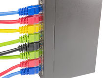 Network cables connected to router Royalty Free Stock Photos