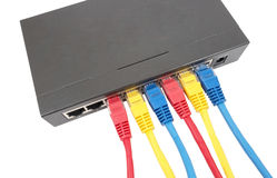 Network cables connected to router Stock Photo