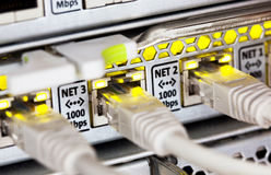Network cables and hub Stock Photo