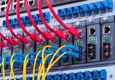 Network cables and hub closeup with fiber optical Stock Photo