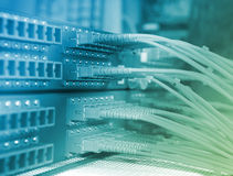 Network cables and servers in a technology data center Stock Photos