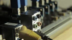 Network card with cable in motherboard. Flashing lamp, signal presence stock footage