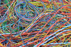 Network chaos of colorful computer cables Stock Photo