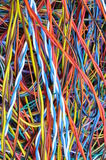 Network chaos of colorful computer cables Stock Photography