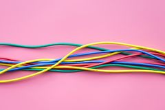 Network colored cables for computer on pink background top view copyspace Stock Image