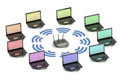 Network computing concept with router and laptops Stock Images