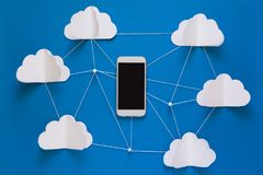 Data communications and cloud computing network concept. Smart phone flying on paper cloud. Network connection and cloud storage technology concept. Data Royalty Free Stock Photography