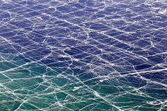 Network of crack on the surface of frozen Baikal lake,Russia stock photography