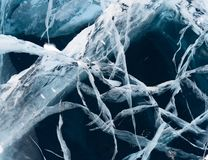 Network of cracks in thick solid layer of ice Royalty Free Stock Image
