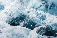 Network of cracks in thick solid layer of ice Royalty Free Stock Photos