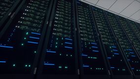 Network and data powerful servers behind glass panels in a server room of a data center or ISP. Racks of Blinking twinkling LED Li