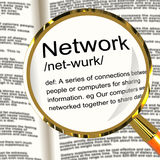 Network Definition Magnifier Showing System Of Computers Or Peop Stock Photo
