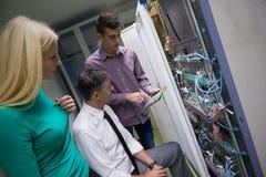 Network engeneers working in network server room Stock Image