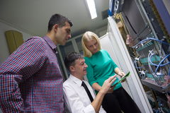 Network engeneers working in network server room Stock Photography