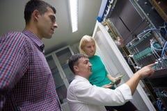 Network engeneers working in network server room Stock Images