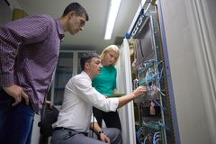 Network engeneers working in network server room Royalty Free Stock Photos