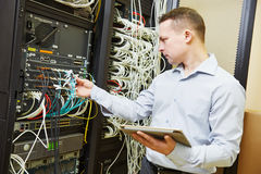 Network engineer admin at data center. Networking service. network engineer administrator checking server hardware equipment of data center royalty free stock images