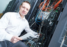 Network engineer administrating in server room. Network engineer technician worker admin during server administration at data center room stock image