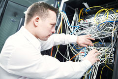 Network engineer administrating in server room. Network engineer technician worker admin during server administrationat at data center room stock images