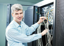 Network engineer administrator in server room. Network engineer admin or server administrator technician worker at data center room royalty free stock image