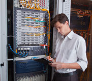 Network engineer in server room Stock Image