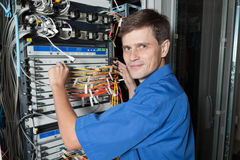 Network engineer in server room Royalty Free Stock Photos