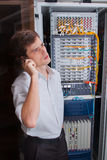 Network engineer in server room Stock Photo