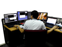 Network engineer woking with multiple monitors stock image