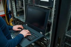 Free Network Engineer Working In Server Room Royalty Free Stock Photos - 86394388